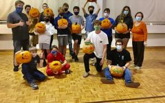 SENIOR COSTAS DELIDAKIS volunteers at his church during the Halloween season to help prepare meals for those in need.  Volunteers also hosted a pumpkin carving competition.