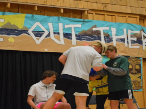 SENIOR WILL MOOREHEAD (right) plays a version of charades at Leadership Workshop  in 2019, when it was last held. He used this experience to meet new people and make several unforgettable memories.