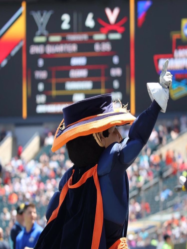 FALCON ALUMNUS CAM Bailey cheers on the Virginia football team as Cav-Man.  He has been undercover as Cav-Man the past four years.