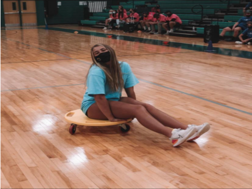 SENIOR NATALIE JONES leads a game for students at the first  Leadership Workshop held at the school. She was excited to have finally been behind the scenes of the workshop after attending for the past four years..