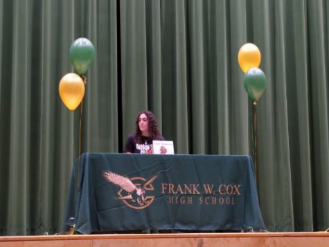 SENIOR TAYLOR KOPASKEY signs her letter of intent to Oregon State University. She will continue her rowing career at the Division 1 level.