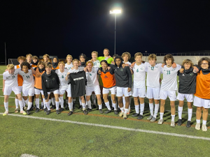 THE BOYS FALCON varsity soccer team celebrate after their big win against the Knights of Kellam  High School. The boys are hopeful that they will make it to the state championship at the end of June.