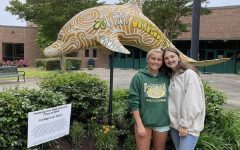 OPERATION SMILE PRESIDENTS, seniors Natalie Jones (left) and Lanie Allen stand in front of the newly renovated flower bed. Jones and Allen worked, along with other club members, after school last week to breathe new life into the flower bed that holds the Class of 2020 statue.