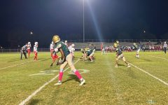 FALCON OFFENSE READIES themselves to score a touchdown against the Cavalier football team. Junior Jordin Cooper was a major asset to the teams success that night.