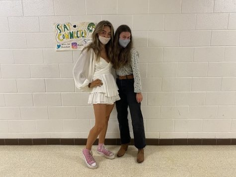 JUNIORS RAMEY BOWER (left) and Anneliese Busch show off their 90s inspired ensembles. Pink converse and mom jeans are reminiscent of that decades style.